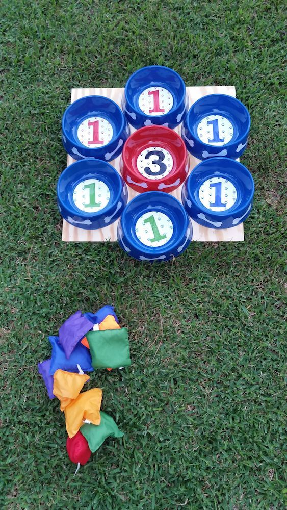 Bean bag toss with dog bowls. Fun activity for a puppy dog themed birthday party