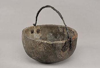Materialssoapstone, iron West Scandinavian, Viking Age Description:Round-bottomed vessel made of soapstone; partially reconstructed, handle and fittings of iron.
