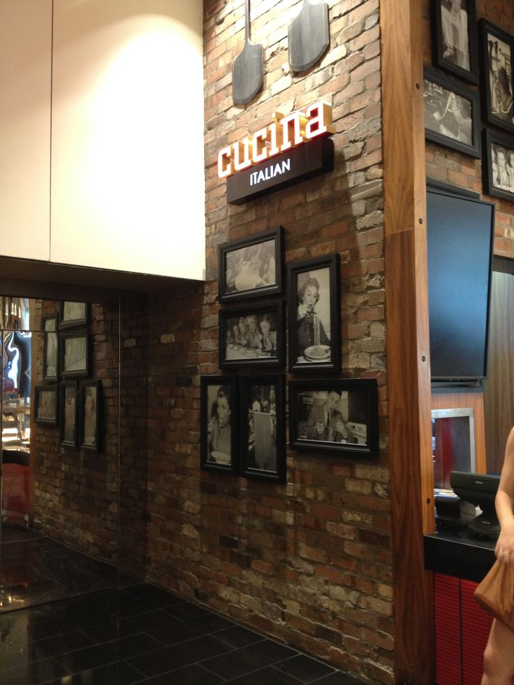 PHOTO 6: The timber and brick facade on  Cucina  in the food court, creates a warm, homely and inviting impression.