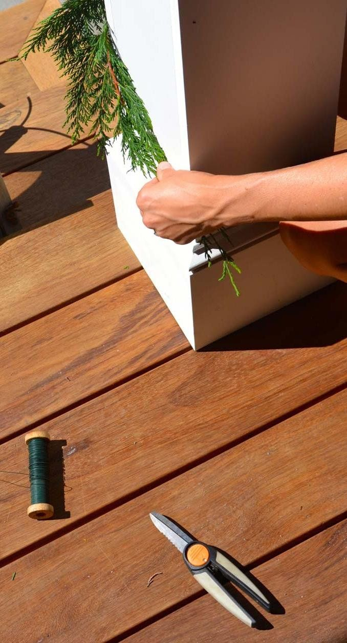 Feeling festive with evergreens as DIY decorations. Find additional tips to creating a festive entrance for your front door here. #fiskars #porchdecor #christmas #diy #gardening