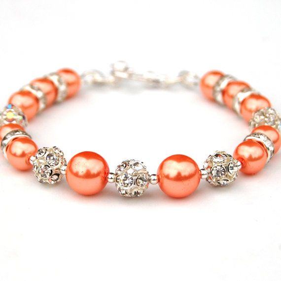 Gorgeous... I love the color! Tangerine Bling Bracelet Orange Pearls and by AMIdesigns on Etsy, $22.00