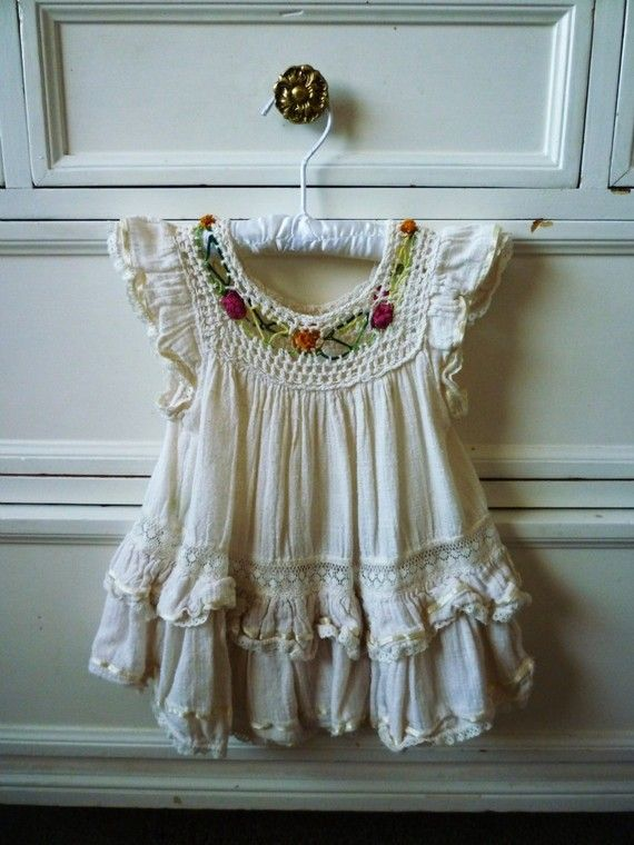 boho baby dress! This would looks adorable with some colorful shoes and a kerchief or flower headband! :)