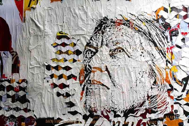 Street Art : Close view of the poster by the artist Vhils at Le M.U.R. in Paris, France.