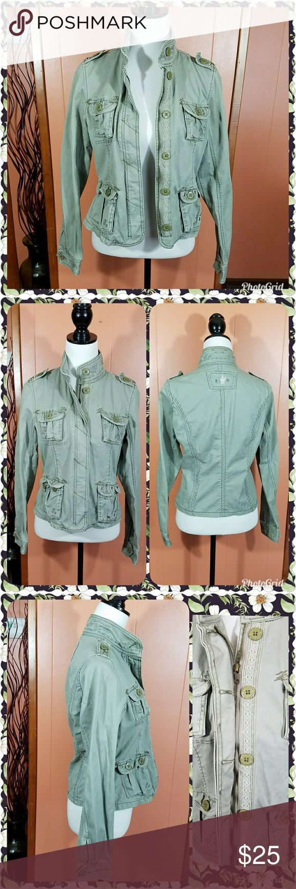 Green utility jacket. This fitted jacket is super cute. It is a beautiful sage green color. It features many details which adds to its charm. There are several pockets on the front. Lace detail on the zipper and button closure. There is gold trim on the inside. And stitching detail on several parts of the jacket. 100% cotton. Excellent used condition. Please feel free to ask questions about size or fit before purchasing. Rapper Jeans Jackets & Coats Utility Jackets