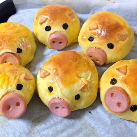 Piggy Biscuit (picture only) - looks like dinner rolls with Vienna sausage triangle ears covered with an egg or milk wash so they bake with a sheen and the ears stay on. After baking cut out the center and push in a Vienna sausage and cut to look like a pig snout. The eyes could be raisin pieces pushed into the rolls. funny food rhs