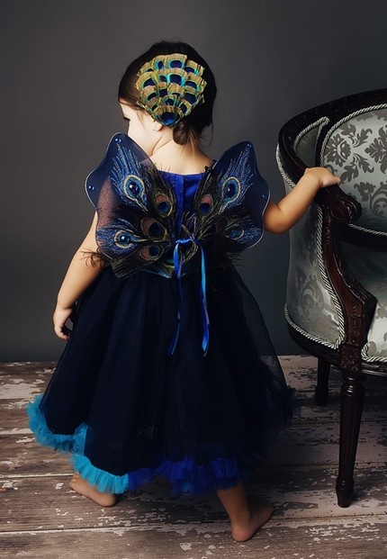 Halloween costume - peacock. Might be a halloween costume but this would be so cute for the peacock themed wedding!