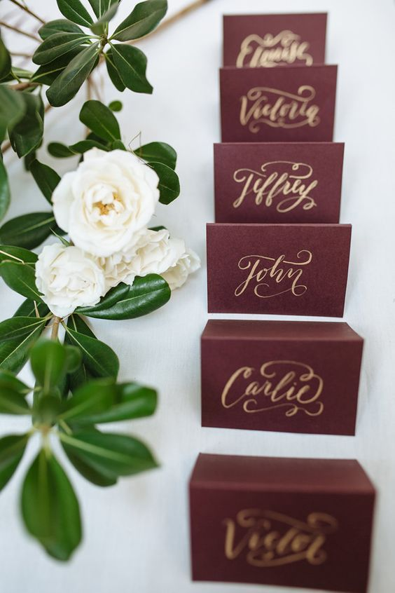 burgundy place cards / http://www.deerpearlflowers.com/burgundy-and-gold-wedding-ideas/