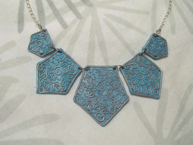 Blue necklace wtith curly tendrils #clay #winter