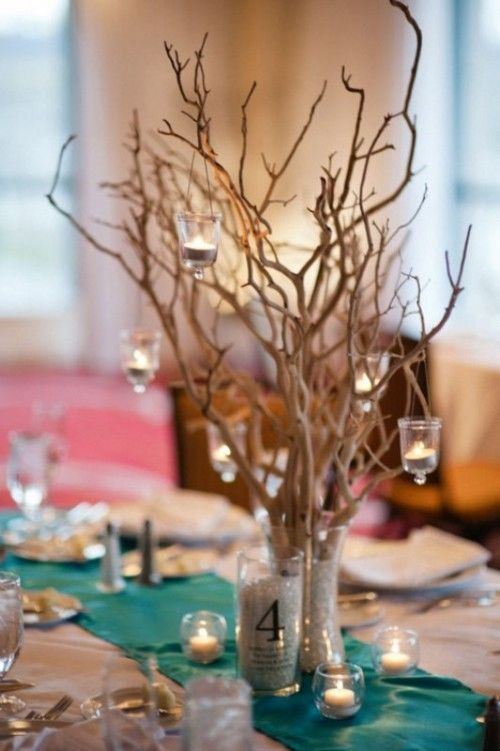 hanging candles from branches rustic beach wedding centerpiece