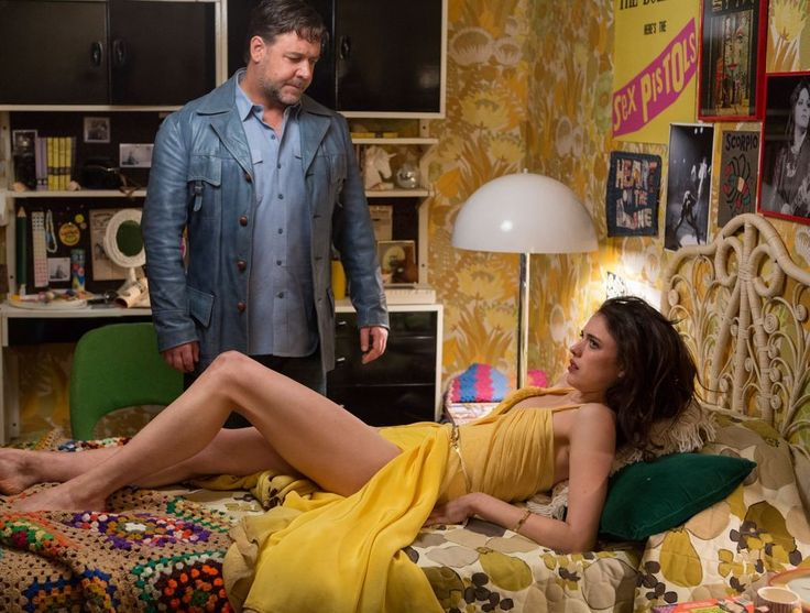 Russell Crowe and Margaret Qualley as Jackson Healy and Amelia Kuttner in The Nice Guys.