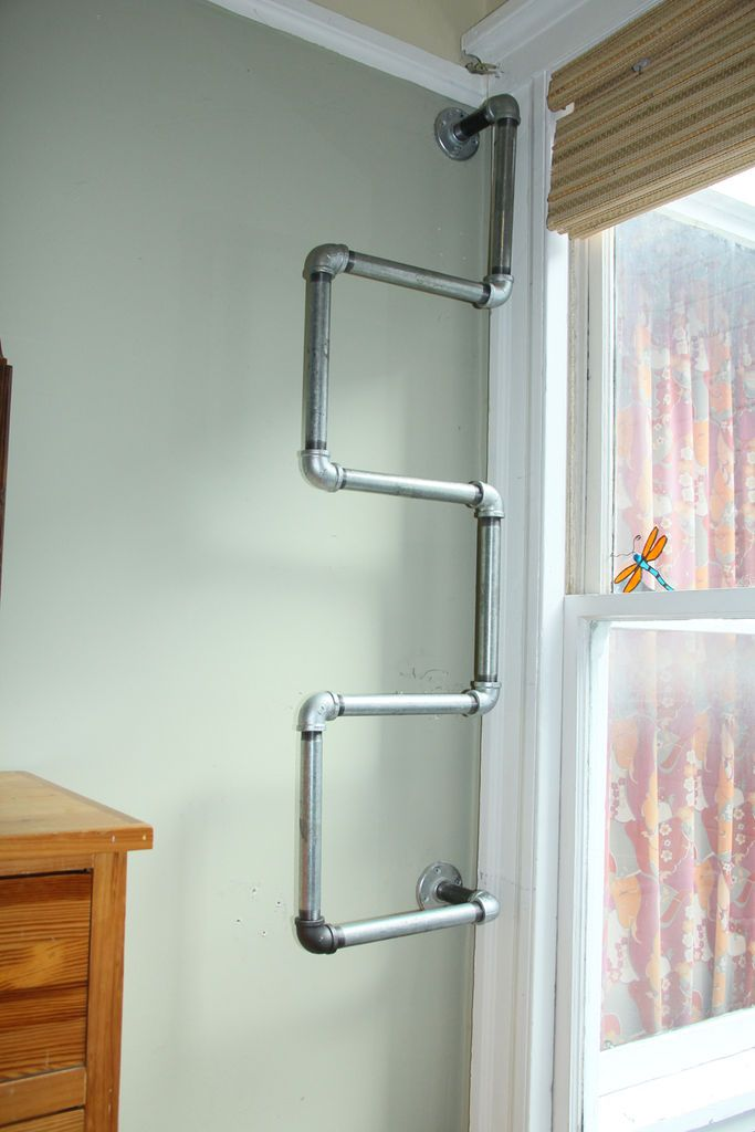 Shelf made of pipes with your hands