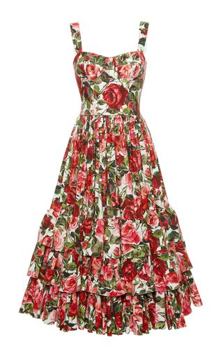Rendered in cotton, this **Dolce & Gabbana** dress features a structured bodice and a tiered and pleated midi length skirt.