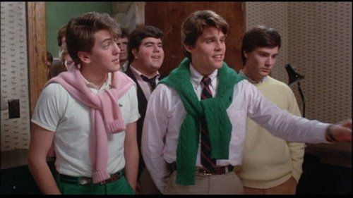 "Preppie look in Making the Grade from 1984. In the picture, the ""preppies"" are wearing a polo shirt, sweaters that were worn tied around the shoulders and nice pants."