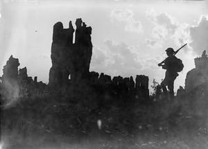 WWI, 5 Sept 1917; British sentry near the ruined cathedral in Ypres. Battle of Passchendaele. ©IWM  (Q 3120)