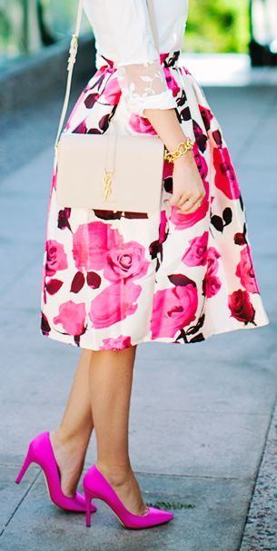 This fabulous pink floral skirt is made chicer with gold accessories