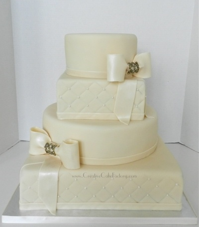 Ivory Bows Wedding Cake By CreativeCakeFactory on CakeCentral.com