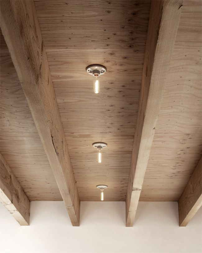 A plywood ceiling accented with raw ceramic based bulbs. Photo from the Dwell House Tour San Diego 2012 via Morgan Satterfield's The Brick House.
