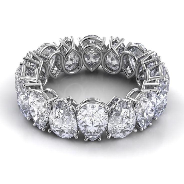 Alternating and inverted diamond pear-cut eternity band . . . v.interesting.