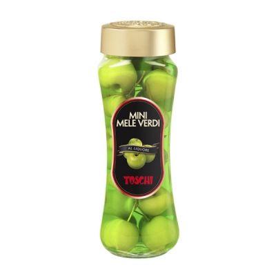 Małe jabłka w alkoholu. Specjalny proces produkcji pozwala zachować naturalne cechy i smak wszystkich owoców.