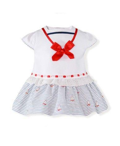 25ef363b41c98 Vestido marinero para bebé niña. Es de piqué en blanco con estampado en la  falda