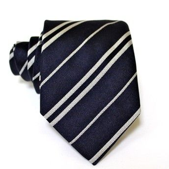 Jacquard tie, 100% silk, blue with single and double oblique white stripes. Ideal for less formal occasions but also special occasions. Pattern and color of this elegant tie can fit with any outfit.