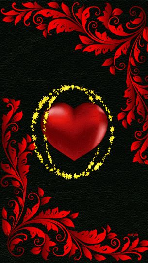 THE RED HEART GETS A LITTLE BIGGER, AND THE GOLD RINGS AROUND IT SPARKLE.