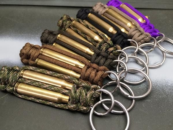 Hand-made paracord bullet key fob. Paired with actual spent, recycled, cleaned & tumbled brass bullet shell casings. Perfect for anyone who loves America, w