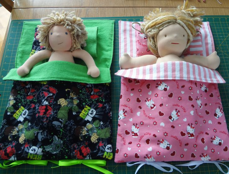 "Doll sleeping bags, specially designed for waldorf dolls with straight arms like Bamboletta dolls, also for 18"" American Girl dolls, Bitty Twin, Bitty Baby and similar dolls.  Matching pillows included.  When not in use, sleeping bags roll up and attach with ribbons at bottom - by #mylittlepoppyseed on #etsy - Visit and like my Facebook page and my Etsy shop - Bienvenue dans ma boutique!  https://www.facebook.com/MyLittlePoppySeedCreations  https://www.etsy.com/ca/shop/mylittlepoppyseed"