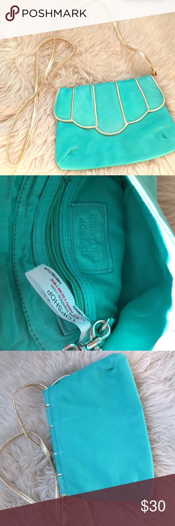 """🆕LISTING: Topshop purse NWOT. Never used. Teal leather and gold piping and strap. Strap can be removed and bag can be carried as a clutch. Zipped pocket inside. 9"""" wide and 6"""" tall. Strap is approx 22.5"""" drop. 🚫TRADES Topshop Bags Shoulder Bags"""