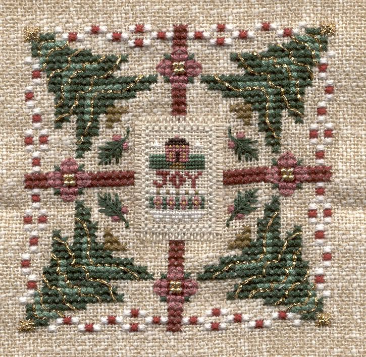 A Little Joy, from the 2002 Just Cross Stitch Christmas ornie magazine. You can also replace the over one stitched JOY with a tiny frame sold by Just Nan.