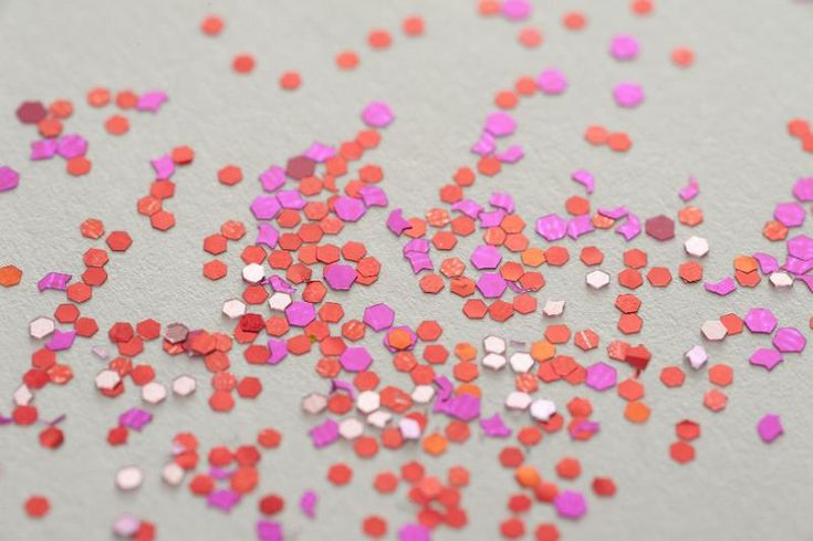 red and pink glitter scattered on a white background - free stock photo from www.freeimages.co.uk