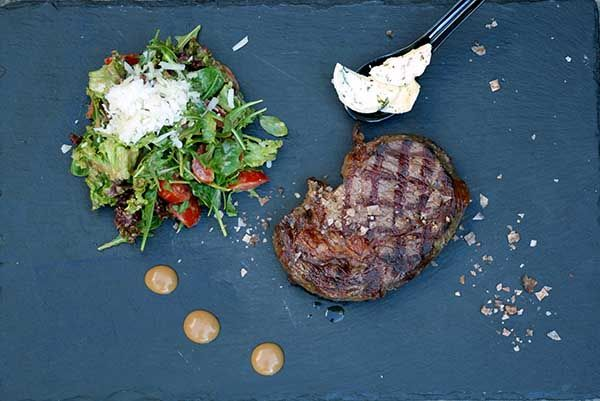 Beef Rib-eye on the grill with smoked salt and butter with fresh herbs, garnished with arugula salad, Cherry tomatoes, gruyere peels and dressing from dijon mustard. Paparouna Wine Restaurant & Cocktail Bar   Our dishes for today!!