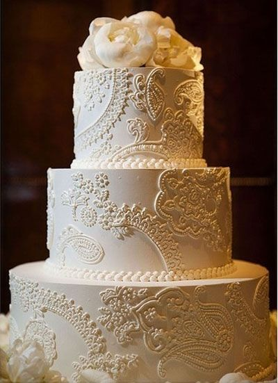 "Elegant wedding cake with ""lace"" accent--would compliment a vintage lace gown perfectly!"