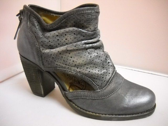 Dkode from Portugal.  Funky summer ankle boot with perforated design and rouched front.  Zip at heel. 8cm heel height.  Distressed black.    Sizes range 37-40.