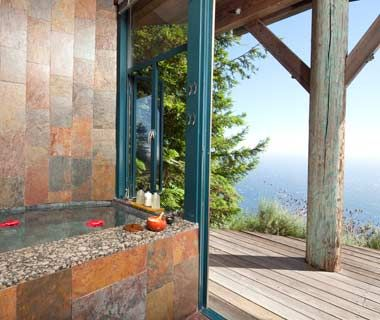 """Post Ranch Inn (Big Sur, CA). """"From the tiled baths in the resort's ocean-view rooms, guests can take in seascapes of the Pacific Ocean and Big Sur coastline. Mountainview include views of the Santa Lucia peaks and rugged Ventana Wilderness. If you want to be even closer to nature, head outdoors for a soak in a stainless-steel hot tub on the private terrace."""""""