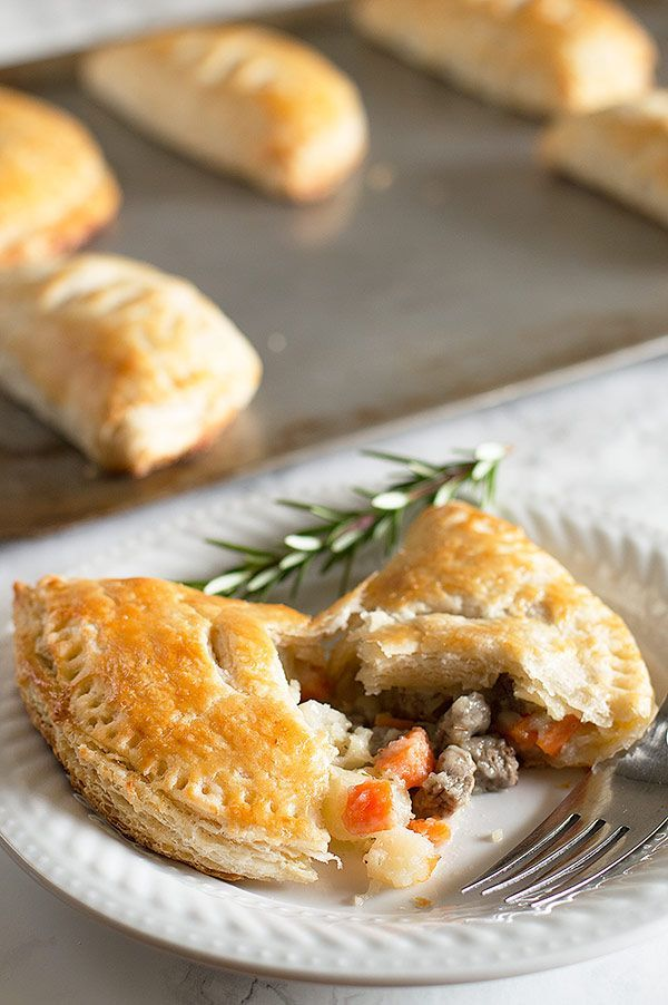 Buttery, flaky buttermilk pie crust wrapped around a savory mixture of steak, carrots, potatoes, and onions. These hand pies are surprisingly easy and one of my favorite recipes to ever come out of my kitchen! Recipe includes nutritional information and freezer instructions. From http://BakingMischief.com