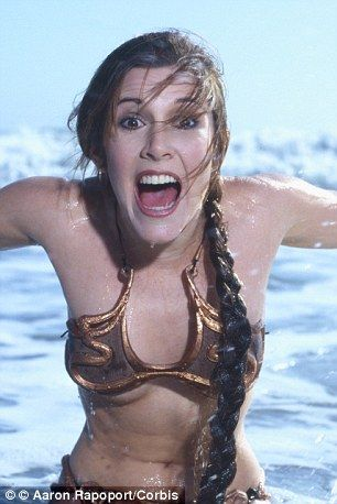 Young Carrie Fisher sizzles in iconic gold bikini in vintage shots
