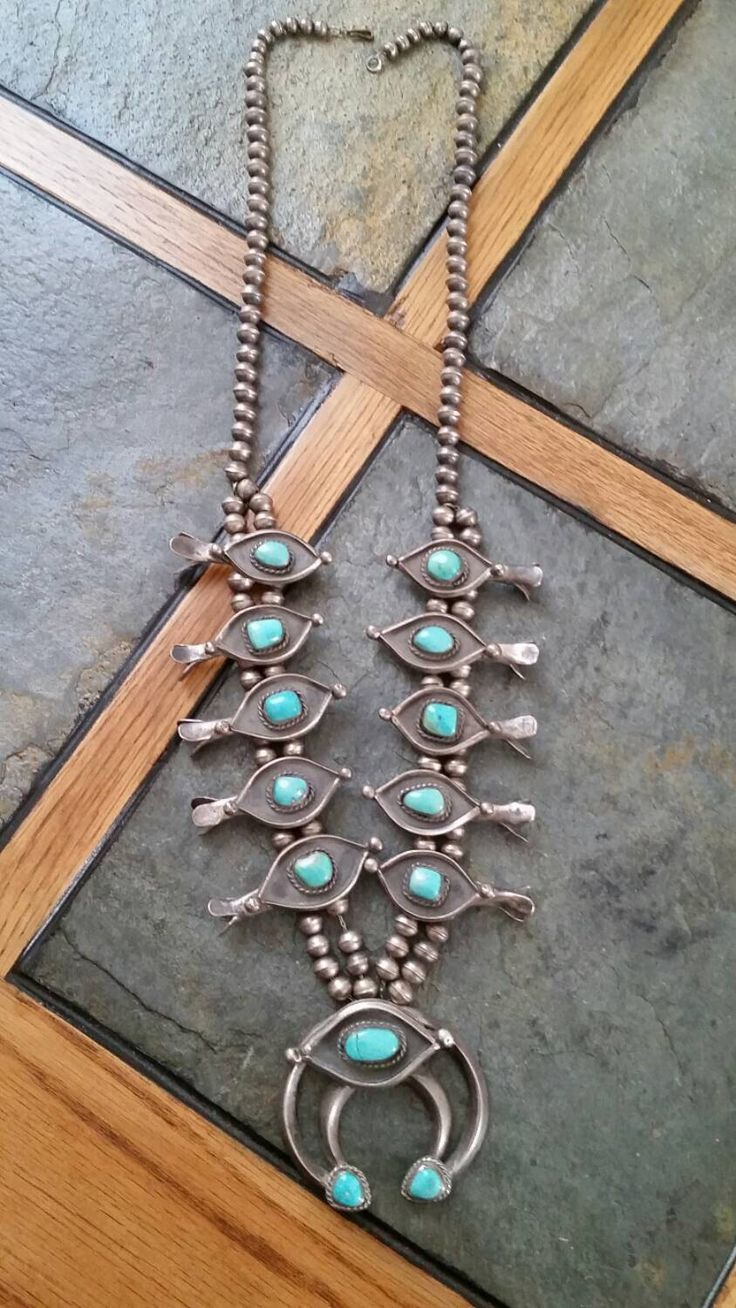 Beautiful Old Collectible Vintage Native American Navajo Sterling Silver Genuine Turquoise Squash Blossom Necklace by NAPAWNJEWELRY on Etsy https://www.etsy.com/listing/244495665/beautiful-old-collectible-vintage-native