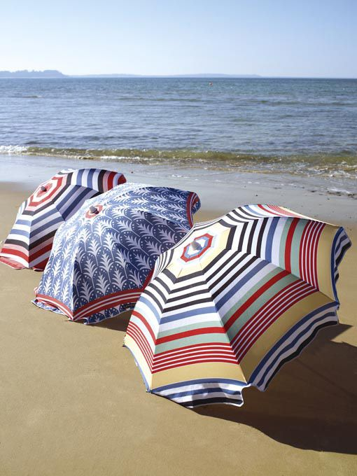Umbrellas on the Beach. I will be taking one of these baby's to the beach this summer. Dont care how silly this looks. Readhead life, No more sun damage for me thanks.