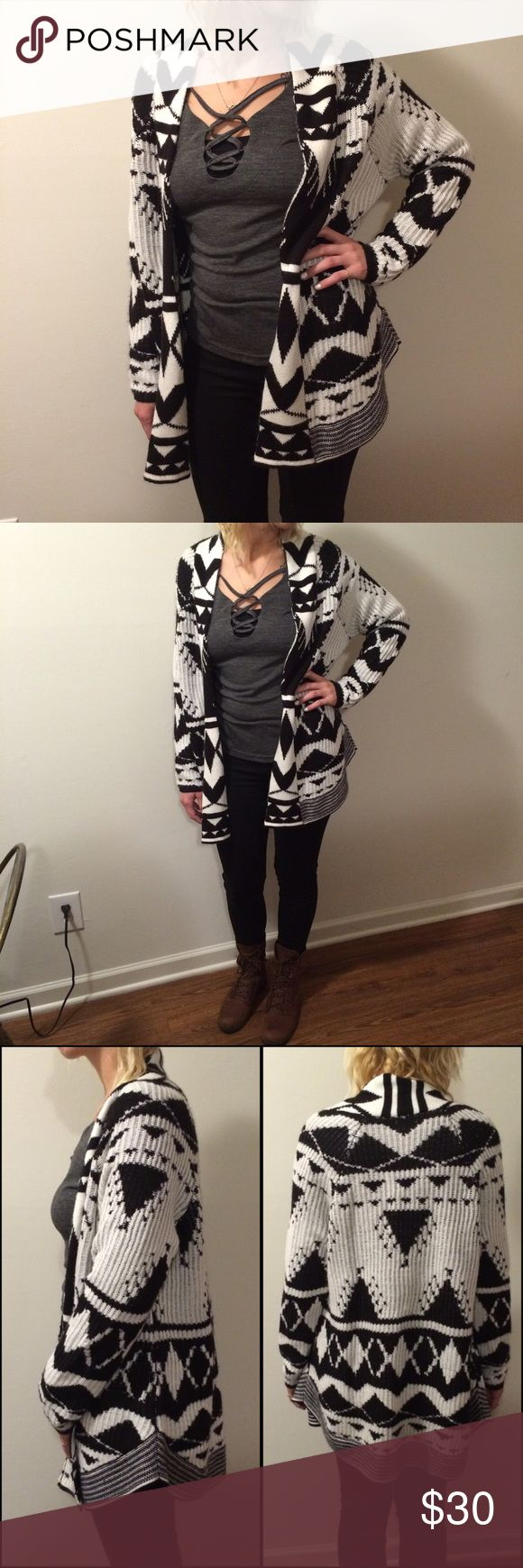 """ND Patterned Knit Cardigan EUC! Like new! Worn once. Super soft, cozy, and adorable! Really cool black & white pattern. The exterior is a defined knit style, whereas the interior is a soft, smooth style. The sides are an attractive scalloped design. Unique piece! 100% Acrylic. Length: 30"""". Bust laying flat: 22"""" arm inseam: 18"""". Fits oversized on a small-medium, model is that size. Ask questions. OFFERS WELCOME! new directions Sweaters Cardigans"""