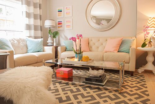 I love this look. Neutral colored furniture with pops of color in different places. And a mixture of classic and modern shapes and textures.
