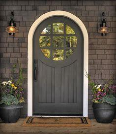Front door with round top. Round window with nine panels.