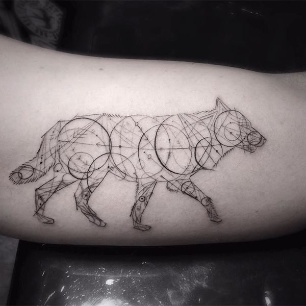 """It all started with a four-leaf clover tattoo he inked on St. Patty's Day at Shamrock Social Club. Today, look for geometric shapes with razor-sharp, intricate line work to spot a true Woo, a style which has become synonymous with his tattoos. """"This wolf made of constellations was the the first time I used my signature circles and lines to create an image,"""" Woo says."""