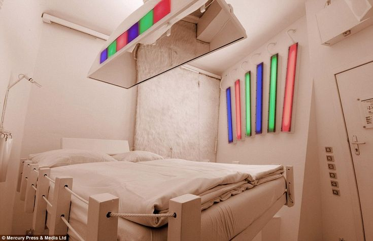 Illuminating: This all-white rooms has coloured bulbs which can be brightened and dimmed and a mirror above the bed so you can 'see yourself in a different life'.