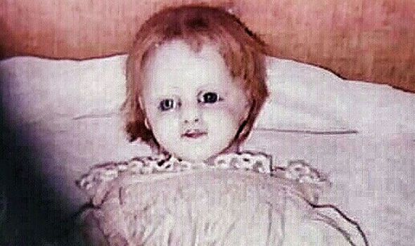 The most CHILLING photograph ever taken: Little girl's doll came to life then VANISHED  IT has a shocking face of white porcelain and a smile to send shivers right down your spine.