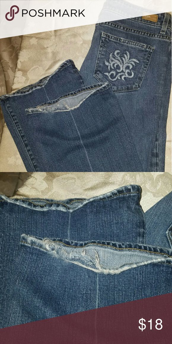 Paige Premium Denim Jeans I would rate these jeans at a 6 out of 10. There are no tears or stains however there is fraying on the hems. Paige Jeans Jeans Flare & Wide Leg