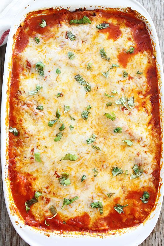 4-Ingredient Ravioli Lasagna Recipe on twopeasandtheirpod.com This quick and easy lasagna is great for busy weeknights or easy entertaining! Everyone loves it!