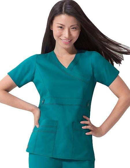 Style Code: (DI-817355) This Dickies solid color scrub top has a mock wrap style and a junior fit. It is designed with princess seams at the front for added shape and a utility snap for extra detail alongside the multi-needle contrast topstitching. It has two large patch pockets plus a multi-sectional pockets for accessory storage and side vents for comfortable movement.