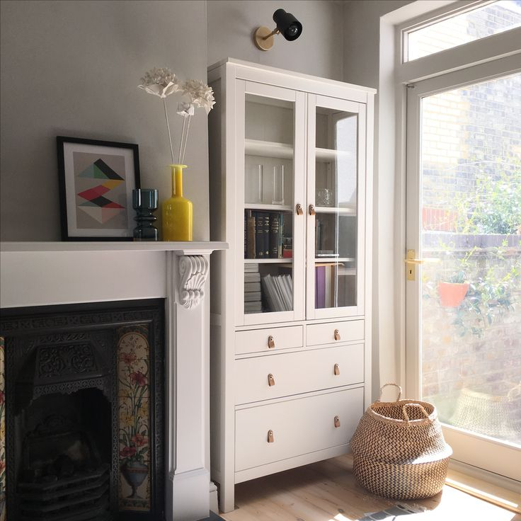 Ikea Hemnes cabinet with Zara Home handles in Victorian terrace living room alcove. Walls: Little Greene French Grey, fireplace surround Farrow & Ball Wevet. Ikea Fladis basket, Pooky Ursula wall light, Holmegaard gulvase in yellow.