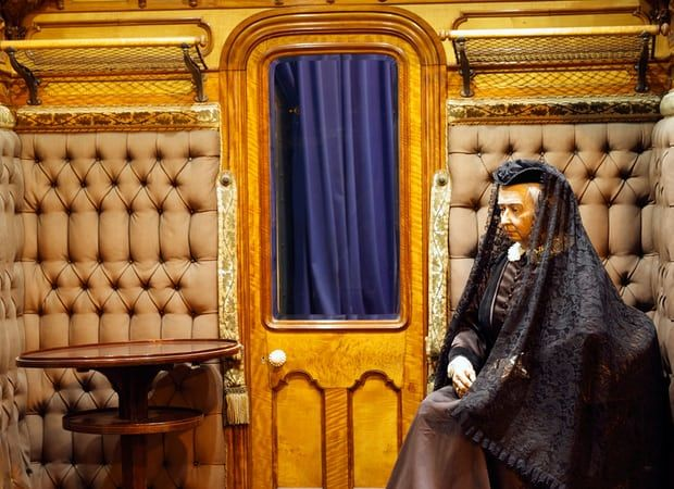 Model of Queen Victoria in one of her royal train carriages on display at The National Railway museum in York.